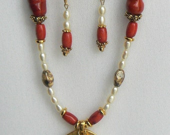 Fresh water pearl dangles on gold disc pendent with coral and gold accent necklace and earrings