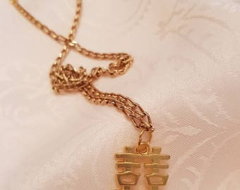Gold chain with lucky symbol