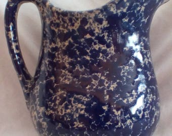 blue and white speckle glazed ceramic pitcher