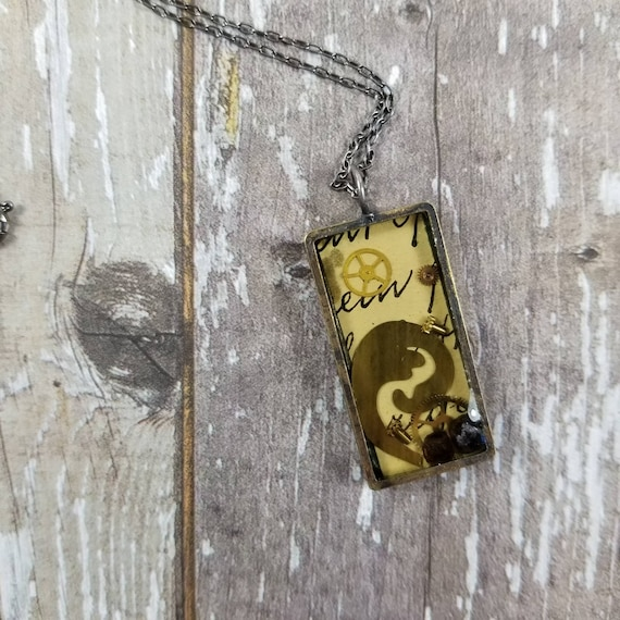 Mixed Media, collaged artwork, resin necklace, No. 4,Watch Parts, Red Garnets, vintage script, jewelry grade resin, altered artwork