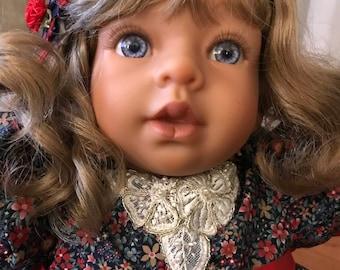 Patty - Short Blonde hair blue eyes.