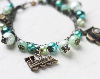 Green Travelling Themed Charm Bracelet Antique Brass Bracelet - World Traveller in Mint Green, Teal and White