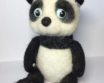 Woolen panda. Handmade. A toy for a gift. Panda doll