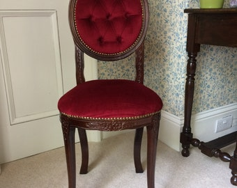 Reproduction side chair with red upholstery