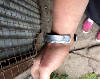 Hand forged iron cuff