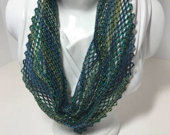 Handwoven beaded necklace in shades of green and blue
