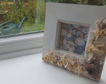 Wooden photo frame with various shells and starfish decorations, seashell picture frame