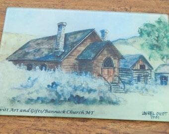 Historical Bannack Church - Hotel Meade - Virginia City - Small Glass Cutting Board with Laurel Ovitt watercolor prints - Western