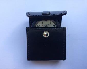 Vintage travel alarm clock with genuine leather case