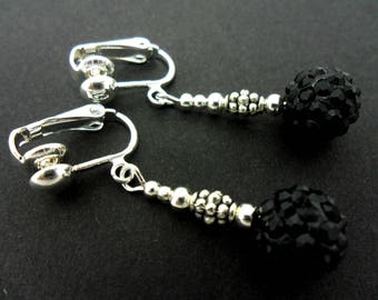 A pair of pretty black shamballa style dangly clip on dangly earrings.