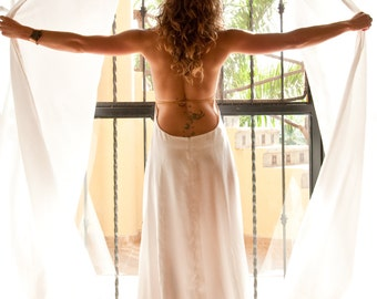 The Aphrodite   by Elika In Love. A boho backless wedding dress, perfect for the beach. Featuring a low back, cowl neckline handmade in silk