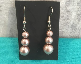 Champagne imitation pearl earrings .