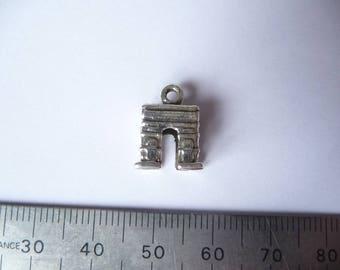 A mini silver Arc de Triomphe