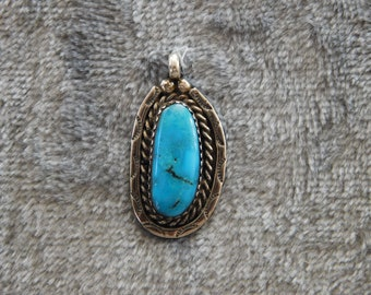 Handcrafted Silver and Turquoise Pendant