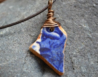 FREE SHIPPING Deep blue glazed ceramic beach pottery with antiqued brass wire wrapping, adjustable darkbrown cotton cord