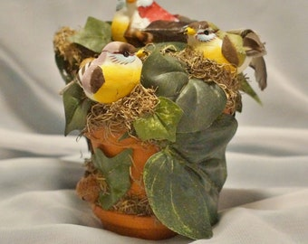 """These """"Three Little Birds"""", inspired by Bob Marley's song, are nestled in a petite clay flower pot waiting to perch in your home or office."""