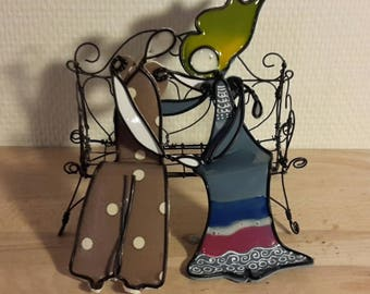 A couple sitting in annealed wire and enamel
