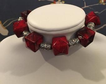 Geometric icositetragon or tetracosagon red beaded bangle bracelet