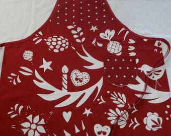 Woman in red cotton apron