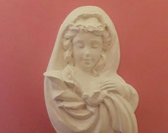 Handmade Lady wearing a lily in plaster.