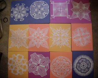 One Dozen (12) Paper Snowflakes