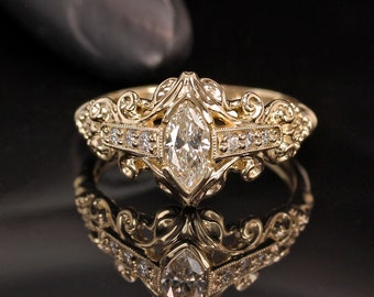 Marquise diamond ring with calla lilly accents.