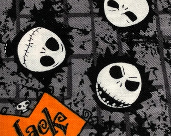 Fabric by the Yard - Disney Nightmare Before Christmas Jack Faces with Orange and Gray