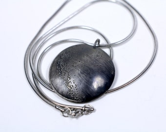 The Far Side of the Moon Pendant // handmade sterling silver lunar pendant // gunmetal // the Satellite Collection from Mod Evil