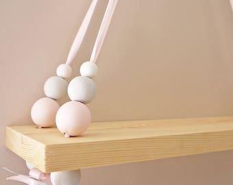 Wooden children baby swing shelf pink grey white bead ribbon nursery interiors nursery decor children's room hanging rack