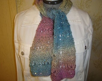 Lacy handknit cool ombre colors scarf with scattered tiny sequins. An all occasion accessory.