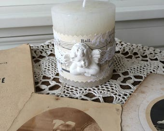 Romantic retro candle: sheet music, lace and Angel