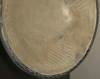 Ancient Chinese Engraved Bowl with fish and a Lotus