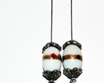 White dangle earrings