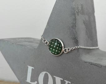 Silver bracelet with green cabochon with beige polka dots