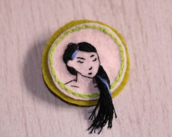 Green and pink pin with long-haired girl