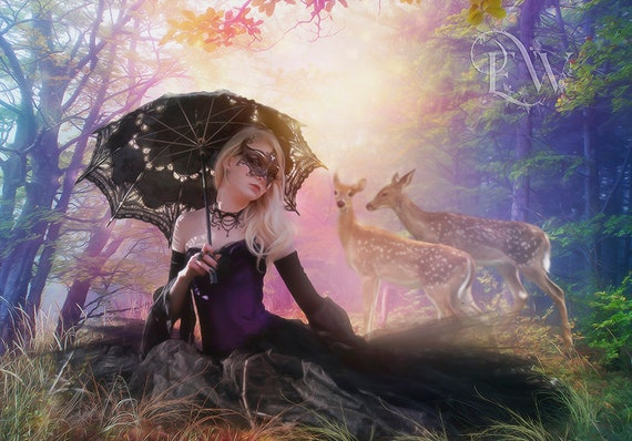 beautiful Gothic fantasy woman in forest with deer