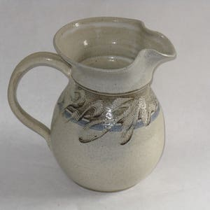 Vintage art pottery pitcher signed