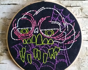 "purple webs skull - 6"" hand embroidered wall hanging"