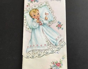Vintage baby's first birthday greeting card, baby holding rattle, flowers & lace