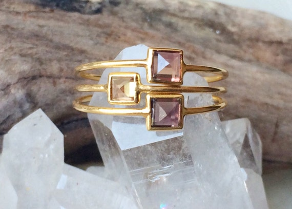 Unheated sapphire and 18k gold pyramid stacking rings