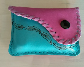 Purse pink and turquoise blue leather cards.
