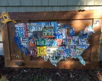 Original handmade license plate map door art.