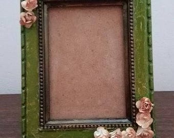 Rustic photo frame with twelve paper beige roses. This photo frame is a magnificent setting for your favorite photos. Vintage, wood, paper.