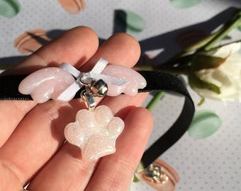 Kitten paw angel wing necklace.