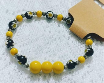 Black and Yellow Beaded Bracelet with Flower Accents