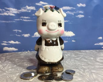 Piggy bank, adorable small miss pig bank coin bank small ceramic money bank super cute apron and flowers on her head