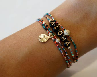 Aloha stretchy bracelet set with 14 KT gold-filled sand dollar charm, beads and rainbow seed beads