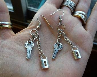 Silver padlock earrings and key. Slopes