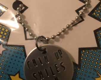 Chin up smiles on necklace or keyring Hunger Games