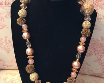 Pink and Gold multi shaped bead necklace